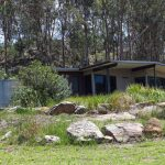 Nestled in a bushland setting with valley views