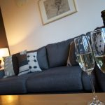Enjoy a cheese platter and glass of wine in front of the gas log fire