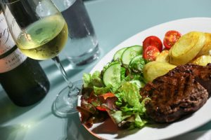 Enjoy a BBQ dinner pack and bottle of Margan wine